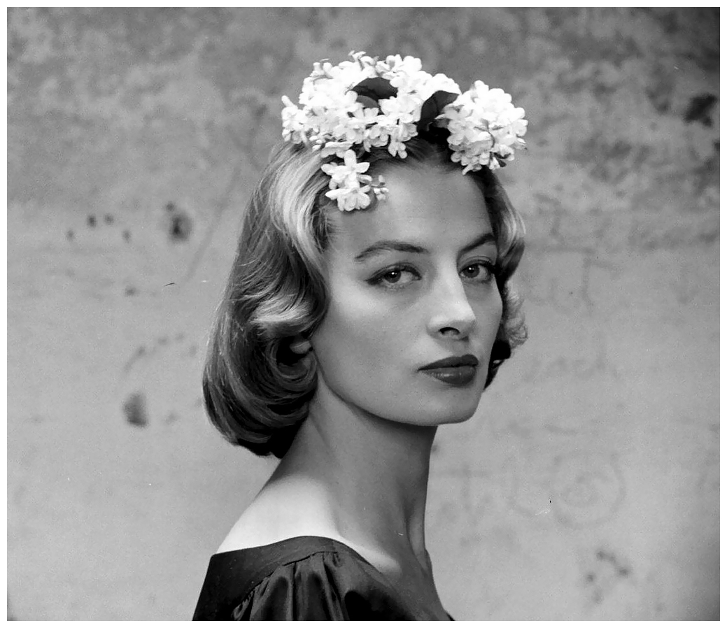 capucine-wearing-flowered-hair-ornament-photo-by-yale-joel-1950s